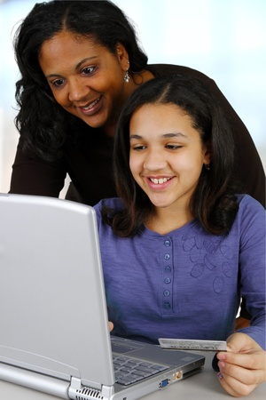 african american mother and daughter: Picture of a child with computer set on white background Stock Photo