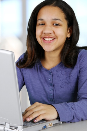 tween: Picture of a child with computer set on white background Stock Photo