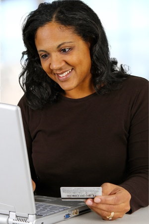 Woman with computer set in her home photo