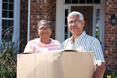 Senior Minority Couple With A Moving Box photo