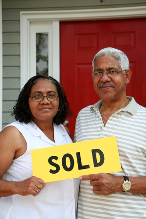 Minority couple selling their home Stock Photo - 13410470