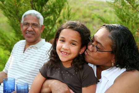 grandmother grandchild: Minority couple at their home Stock Photo