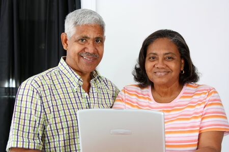 minority couple: Senior Minority Couple Working On A Computer