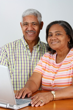 Senior Minority Couple Working On A Computer Stock Photo - 13399514