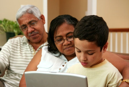 Child on computer with his grandparents