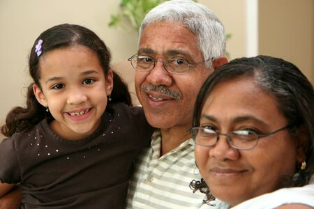 extended family: Child with her grandparents