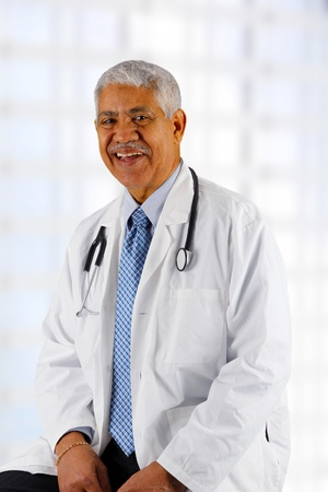 health professionals: Minority senior doctor working at the hospital