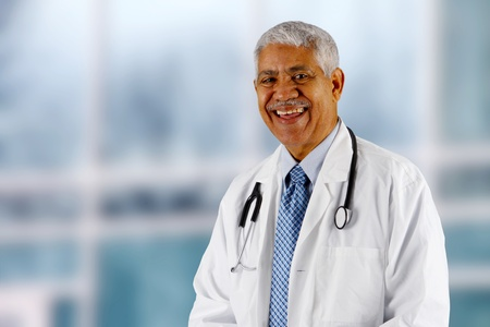 Minority senior doctor working at the hospital photo