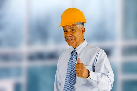 Senior minority construction worker on the job site photo