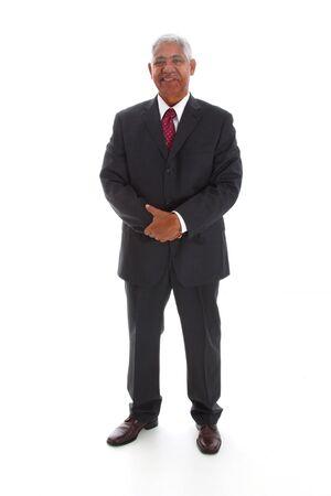 powerful man: Minority businessman set against a white background