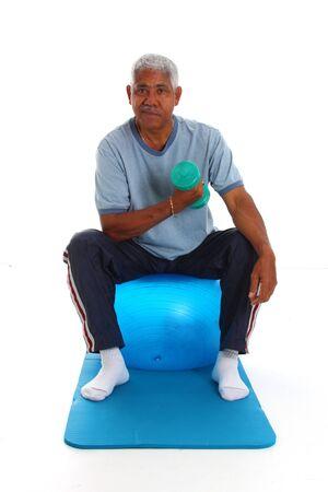 Senior hispanic man working on a white background photo
