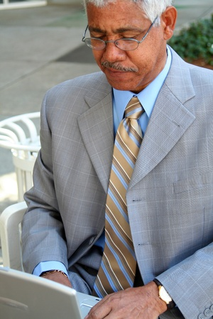 Businessman working on his computer in the downtown area photo