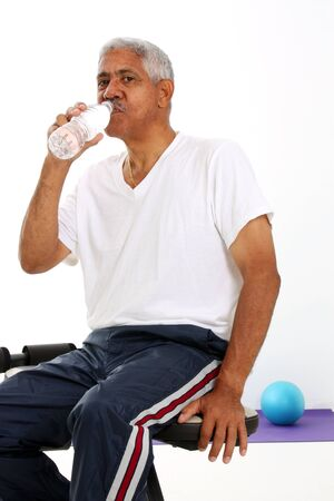 Senior Minority Man Working Out Set On A White Background Stock Photo