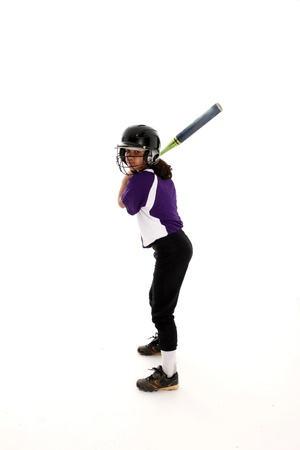 softball player: Playing the game of softball with a white background Stock Photo