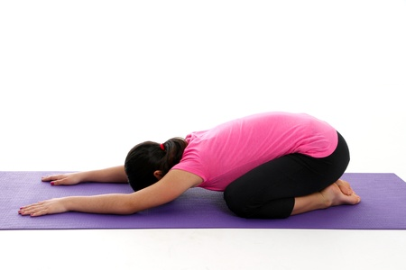 Girl Doing Yoga Pose in a Studio photo