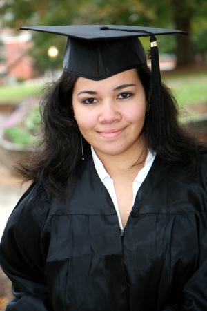 Teenager attending her graduation with cap and gown photo