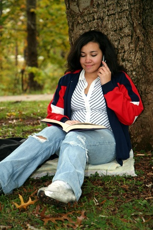 Teenager with studying for a test outside at school Stock Photo - 13400027