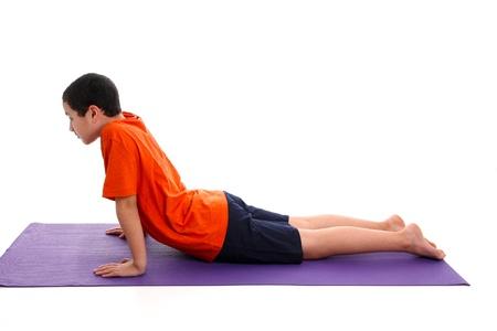 Boy Doing Yoga Pose in a Studio