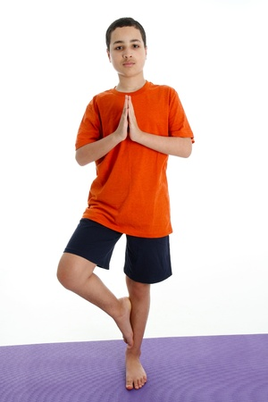 Boy Doing Yoga Pose in a Studio Stock Photo - 13399462