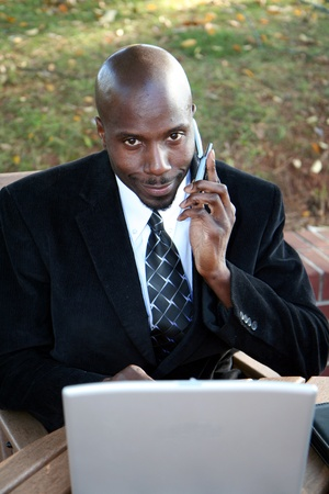 Young businessman outside dressed in a suit photo