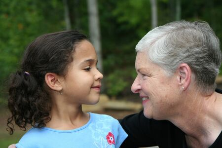 grandaughter: Happy Senior Woman with Grandaughter Outside Stock Photo