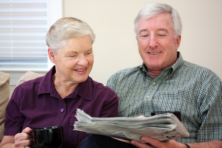 Senior Couple Sitting Together In Their Home Stock Photo - 13399262