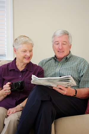 Senior Couple Sitting Together In Their Home Stock Photo - 13399735