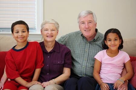 interracial marriage: Grandparents together with their family at home