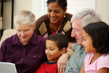 interracial love: Grandparents together with their family at home