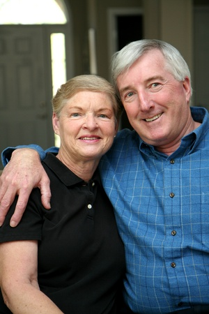 Senior couple together in their home Stock Photo - 13400387
