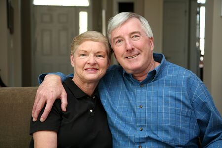 Senior couple together in their home Stock Photo - 13408651