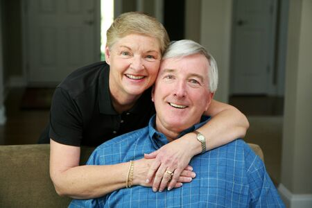 Senior couple together in their home Stock Photo - 13408956