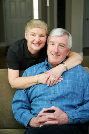 Senior couple together in their home Stock Photo - 13400172