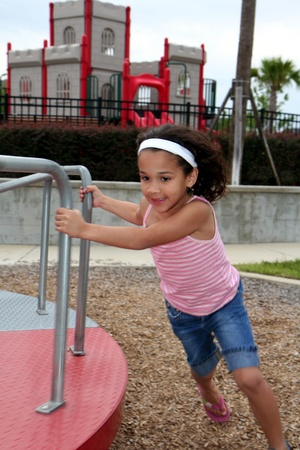 school playground: Young girl outside playing on a playground Stock Photo