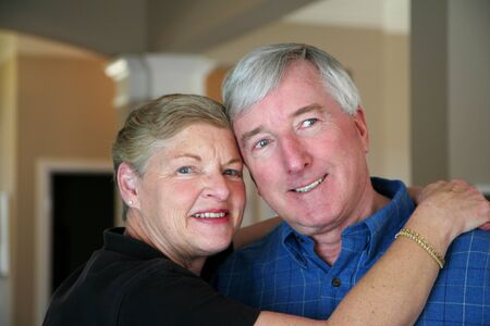 Senior couple together in their home Stock Photo - 13409130