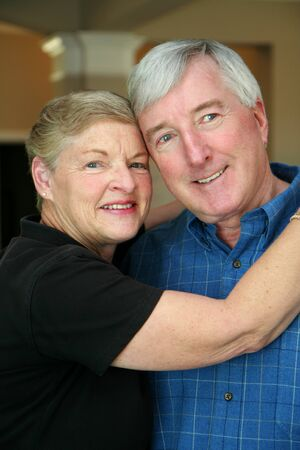Senior couple together in their home Stock Photo - 13408817