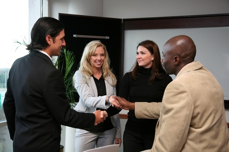 Business Team of workers shaking hands on a deal photo
