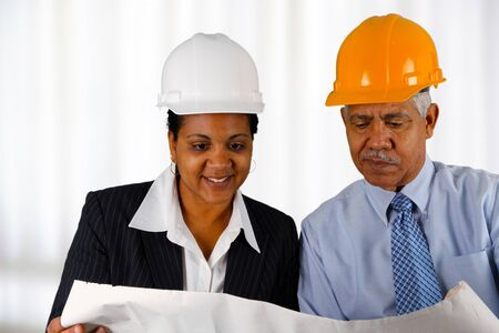 Construction workers working on a job together Stock Photo - 13399275