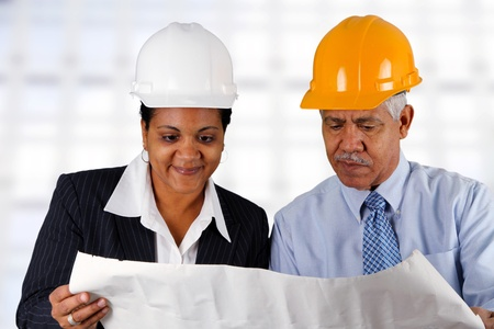 Construction workers working on a job together Stock Photo - 13399088