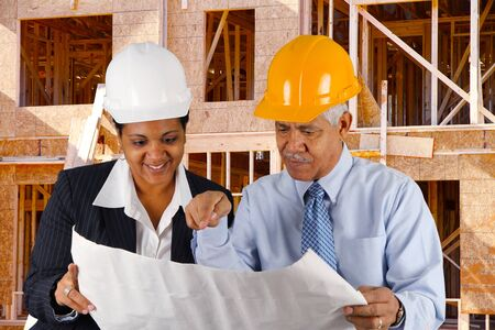Construction workers working on a job together Stock Photo - 13398790
