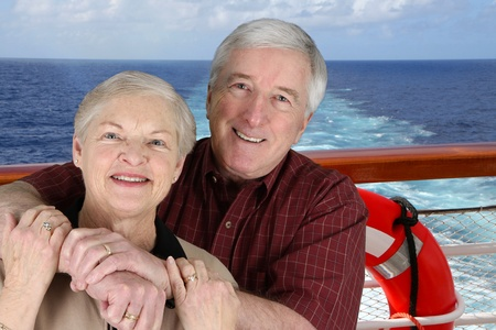 cruise travel: Senior Citizens on a cruise ship pointing
