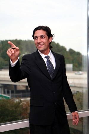 Businessman working in an office dressed in a suit photo
