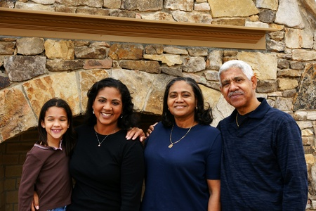Minority family standing in their home