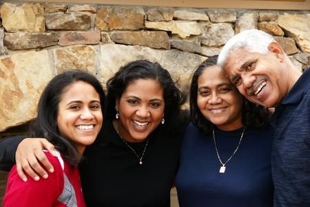 minority: Minority family in their new home Stock Photo
