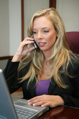 Businesswoman working on a computer in a conference room photo