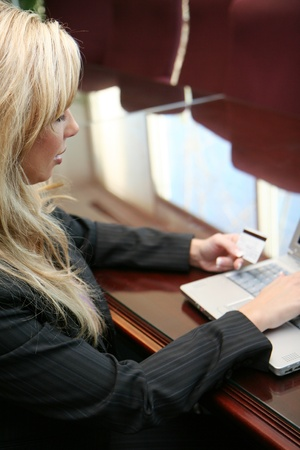 Woman doing online shopping with her credit card