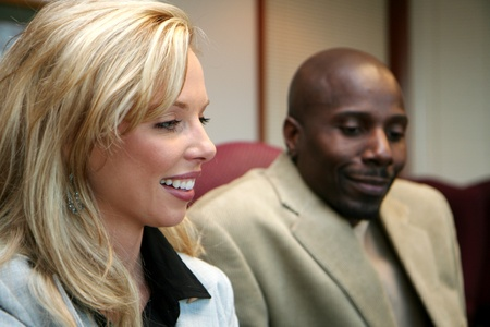 Young caucasian businesswoman with african american man photo