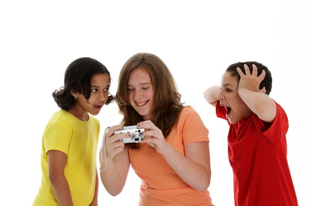 Girls looking at a camera on white background Stock Photo - 13400272