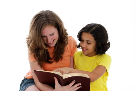 study group: Girls having a bible study on white background