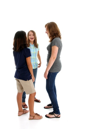 children talking: Teenage children in colorful shirts against a white background Stock Photo
